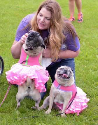 HSHV staff member Cathryn O'Connell with two dogs at Walk & Wag