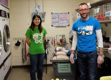volunteers doing laundry