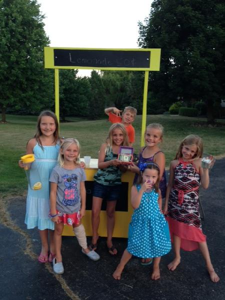 Kids earning money for the animals with a lemonade stand